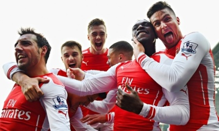 Arsenal celebrate after Danny Welbeck's goal at West Brom